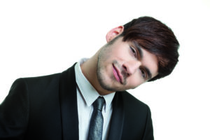Concentrated man with head tilted